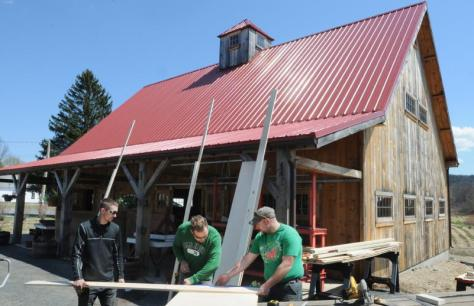 left, Tom Devine, Stephen Giard and Robert Brennan, all employees of Kevin Gray Building out of Northfield work on the barn at Atlas Farm.