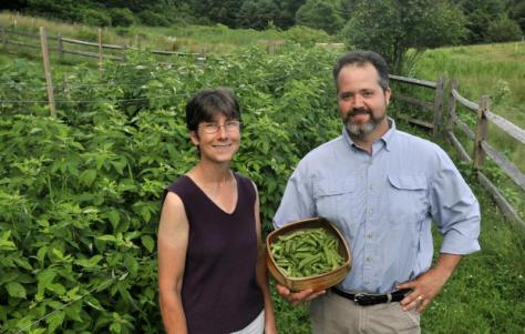 Becky Reed, owner of One More Gambol Farm, and Bernard Brennan, owner of Amethyst Farm, stand near Reed's garden at her farm in Amherst Tuesday. They are two of seven members of the incorporating board of directors for the All Things Local Store planned for downtown Amherst. JERREY ROBERTS